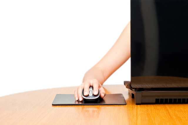 Hand on the Mouse and Laptop