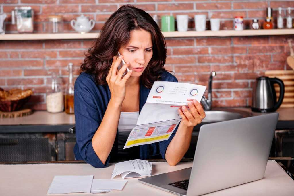 Woman with Utility Bills