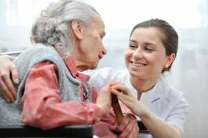 Hospice employee taking care of the patient
