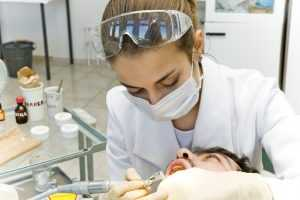 Dentist cleaning teeth