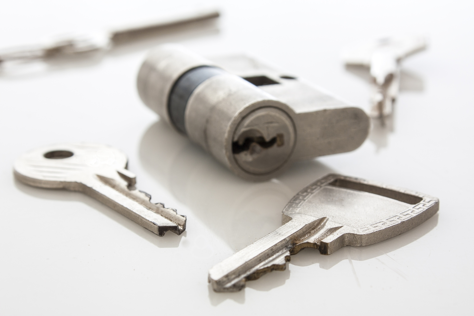lock and keys on a white table