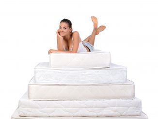 Woman on a pile of mattresses
