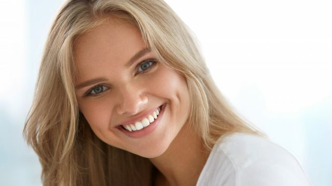 Woman Smiling with Her Teeth Showing