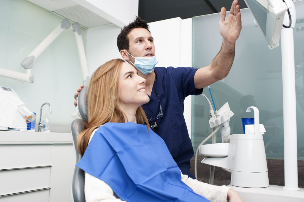 a dentist explaining denta results with a patient