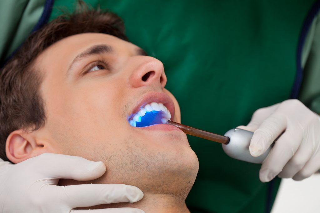 Man getting a checkup with a cosmetic dentist