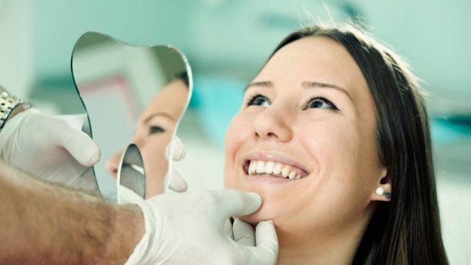 Woman smiling during a dental checkup