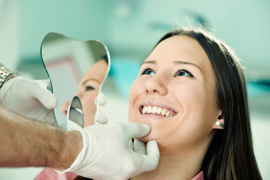Woman smiling during a dental checkup