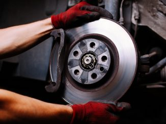 A car's brakes being repaired