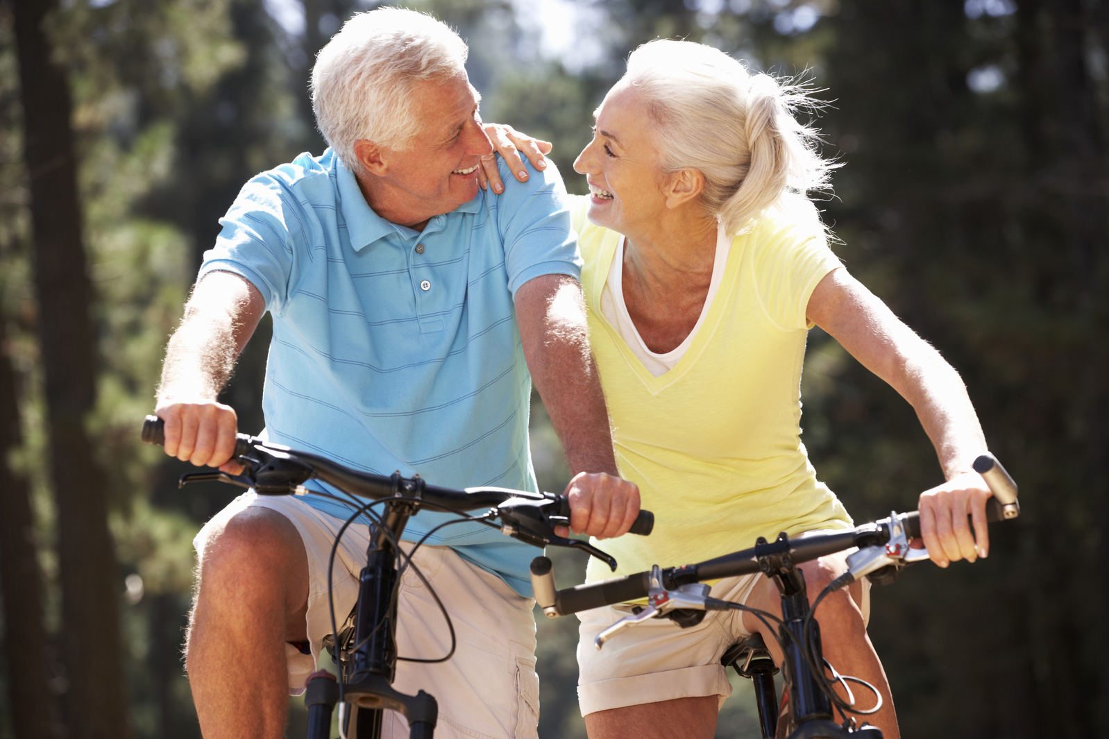 Retiree couple riding bicycles