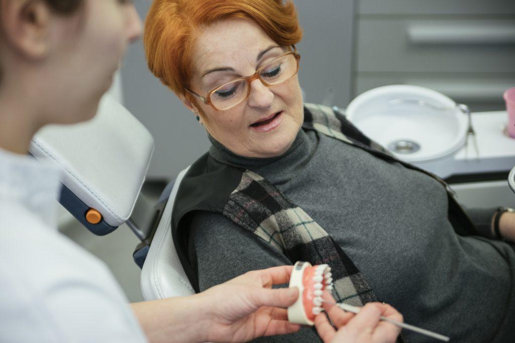 Dentist showing patient's dentures