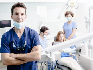 Dentist in dental clinic