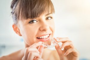 Woman wearing her invisalign