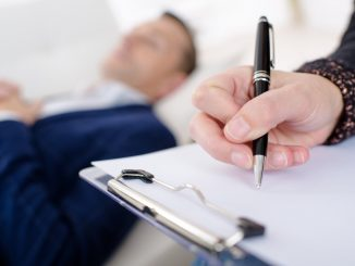 Psychiatrist taking notes during a session