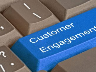 keyboard with words customer engagement