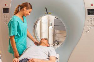 nurse preparing man for CT scan
