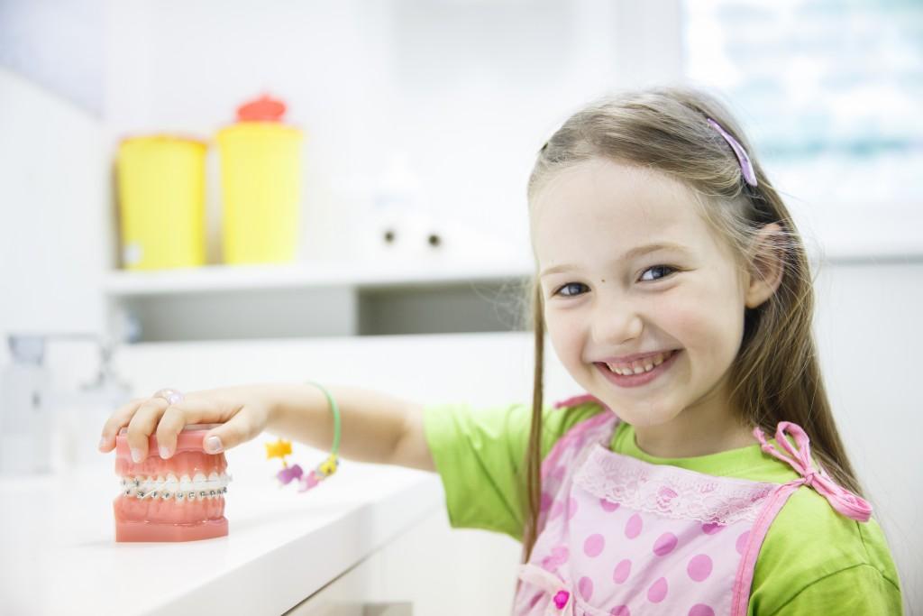 Smiling girl at dentist's office