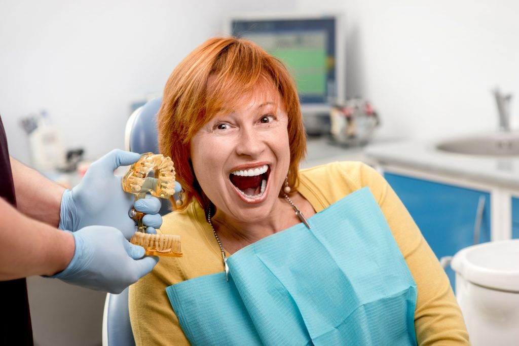 Woman with new dental implants
