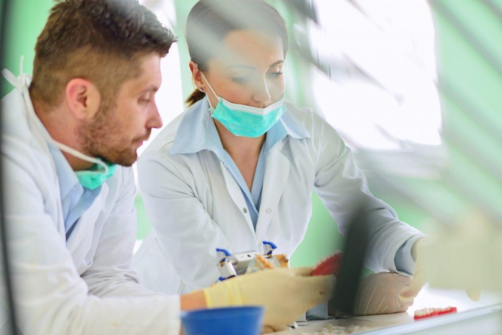 Dentists working on dentures