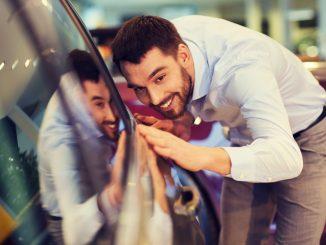 Man checking car exterior