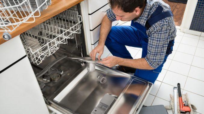 a man repairing the dishwasher