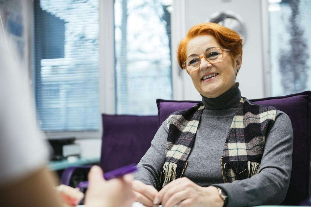 elderly woman wearing a scarf