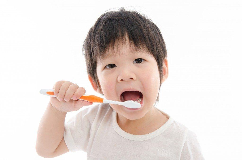 Little boy brushing teeth