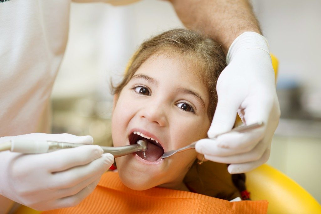 Kid Getting Her Teeth Checked