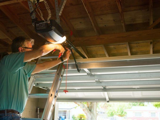 Man inspecting his garage door