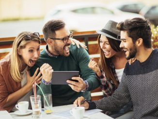 Friends having fun with a smartphone