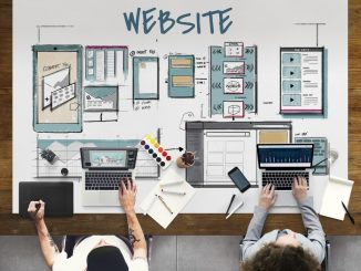 Employees working on a website layout