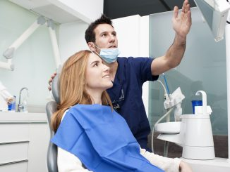 a dentist explaining something to the patient