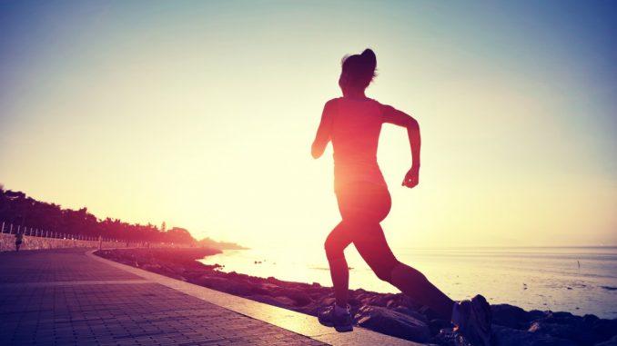 woman jogging at daybreak