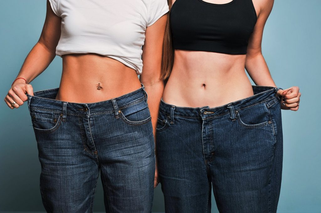 Women showing off their old pants