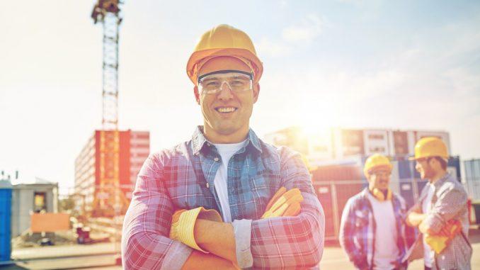 Builders in hard hat