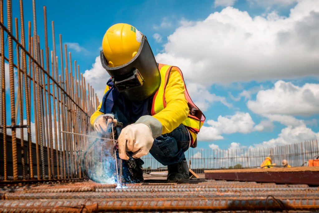 Construction worker welding at the site