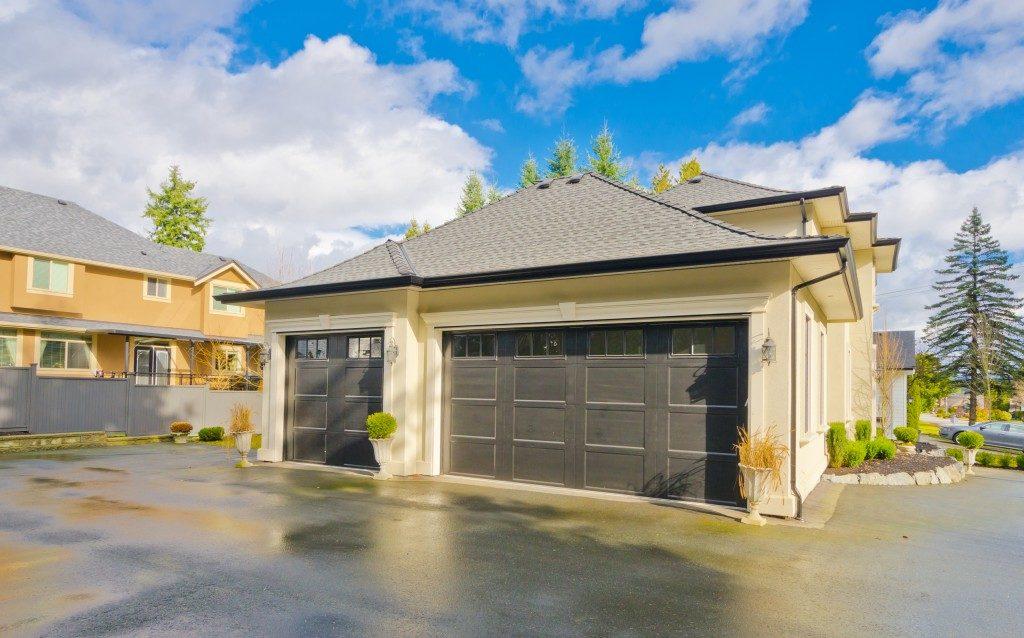 a concrete driveway and garage