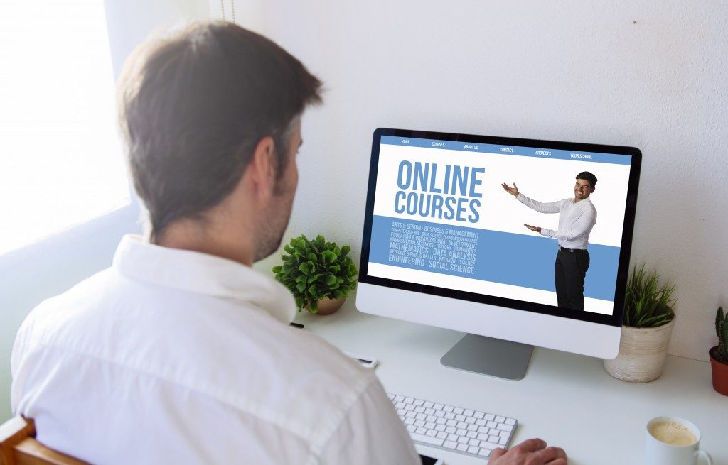 man checking online course software