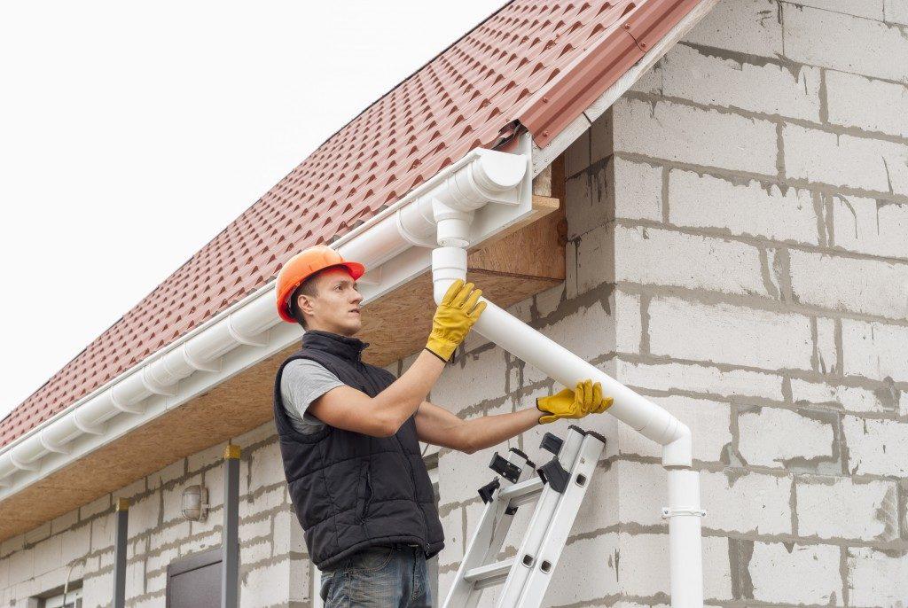 Worker holding a gutter