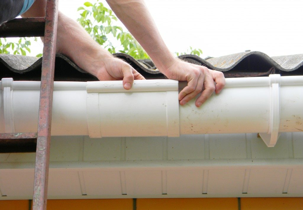 Man fixing rain gutter