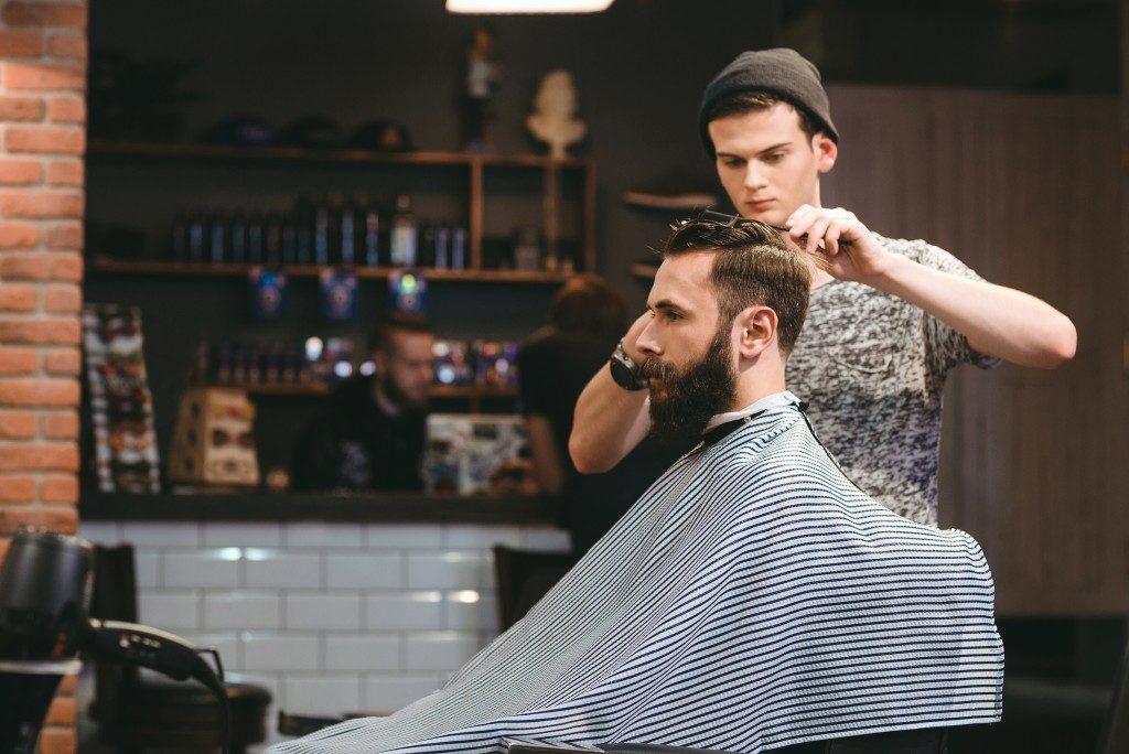 barber styling bearded man