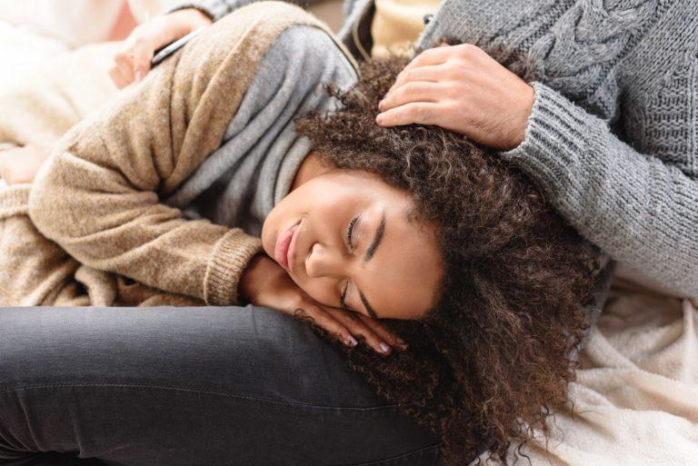 Woman-sleeping-on-lap