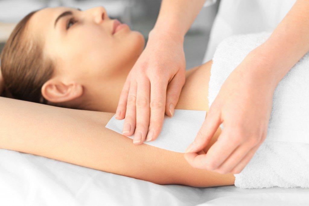 underarm waxing in a spa center