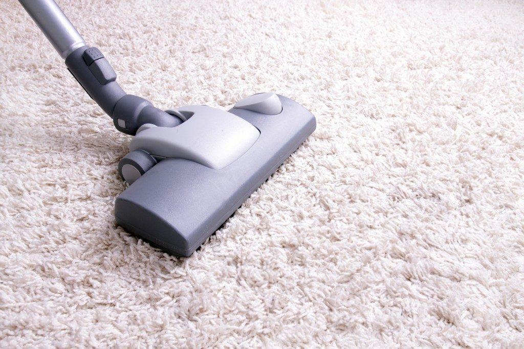 vacuumming the carpet