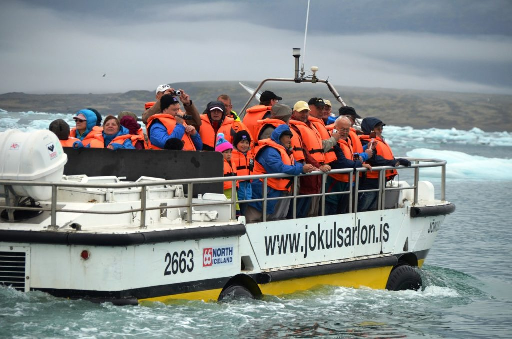 Amphibious vehicle filled with tourist in open water