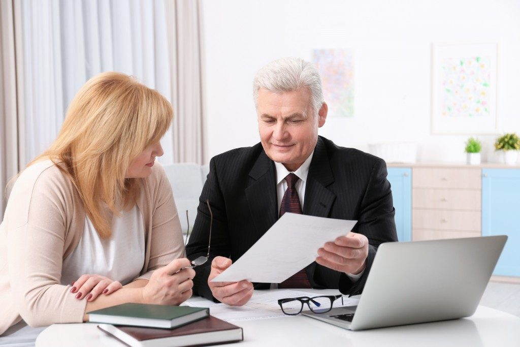 woman talking to a business professional