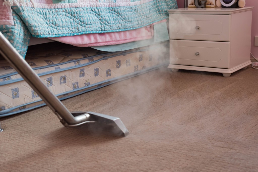 Regularly cleaning the carpet in the bedrooms