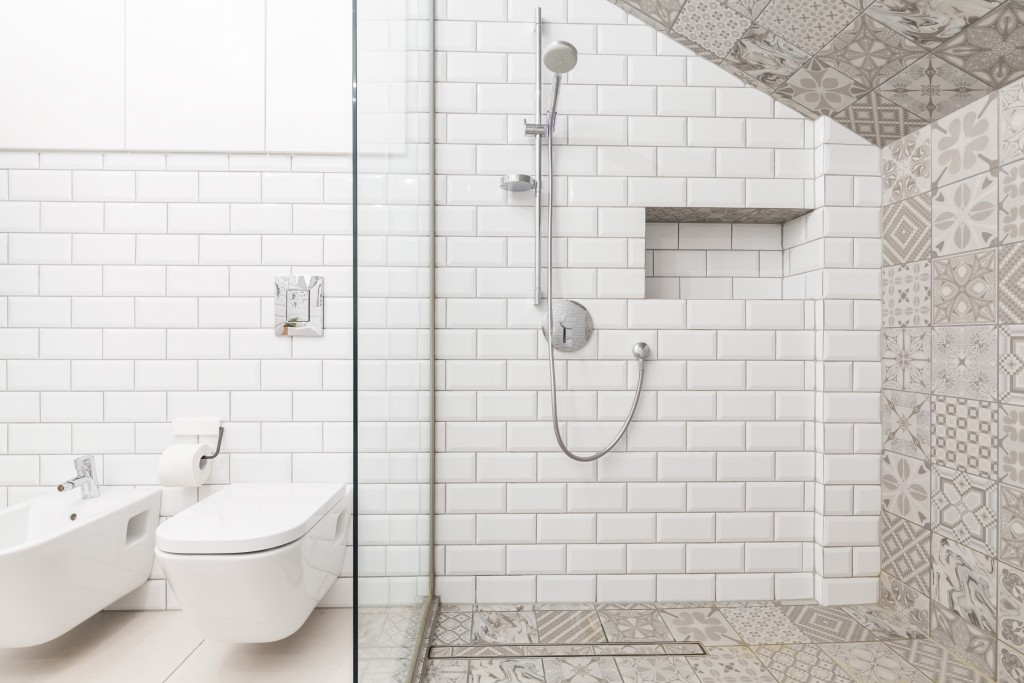 bathroom with white and decorative tiles