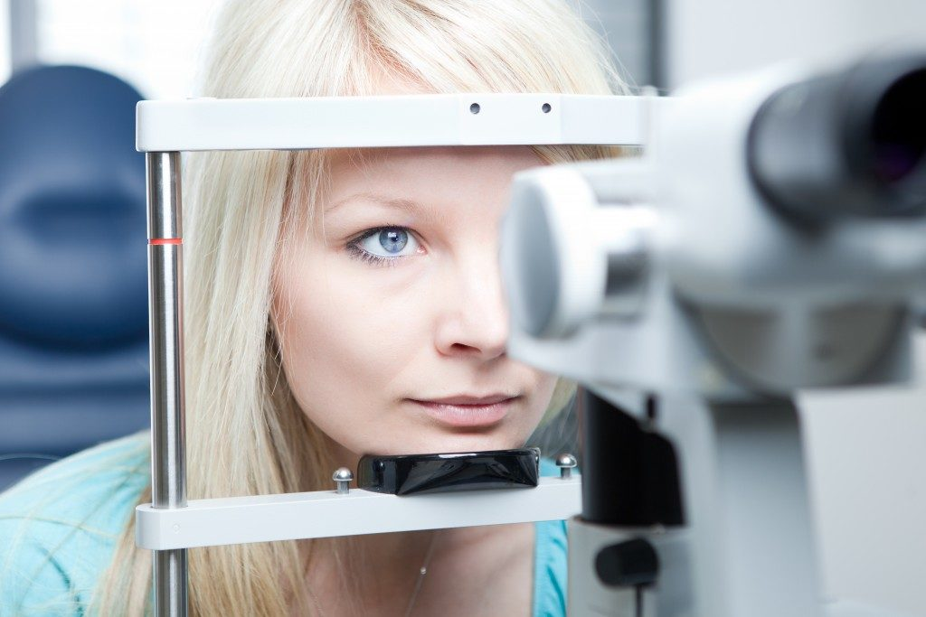 woman having her eyes checked