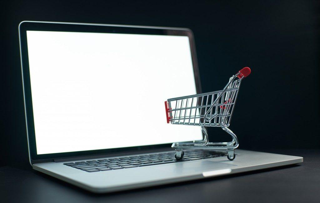 miniature cart on top if a laptop
