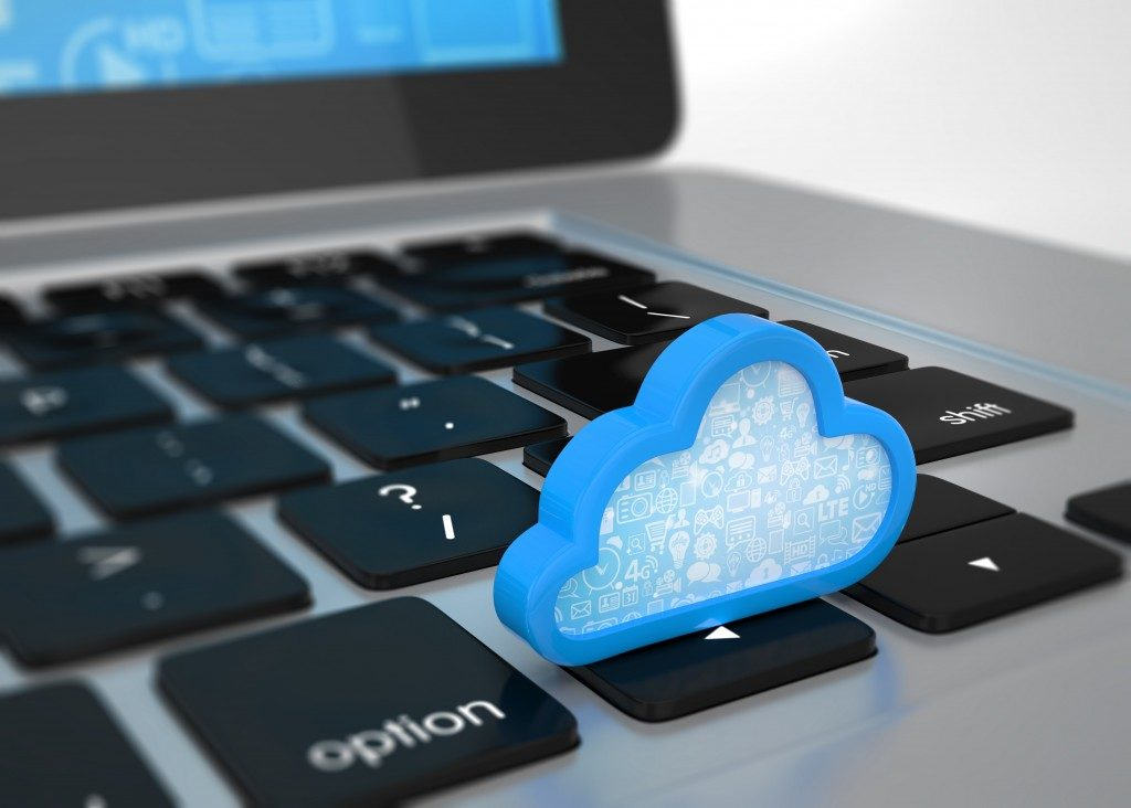 Laptop with cloud computing symbol